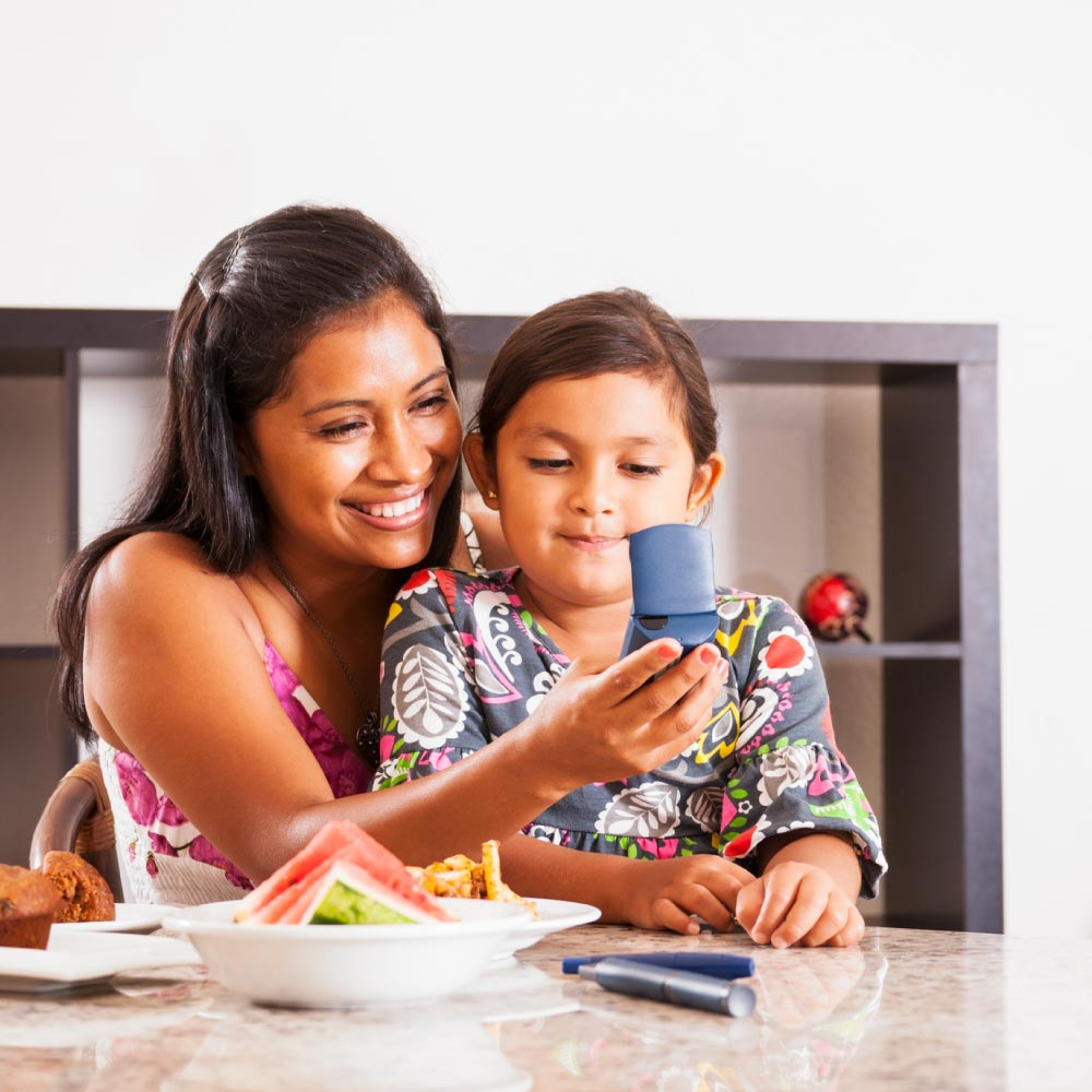 Woman and Child Reading Diabetes Results