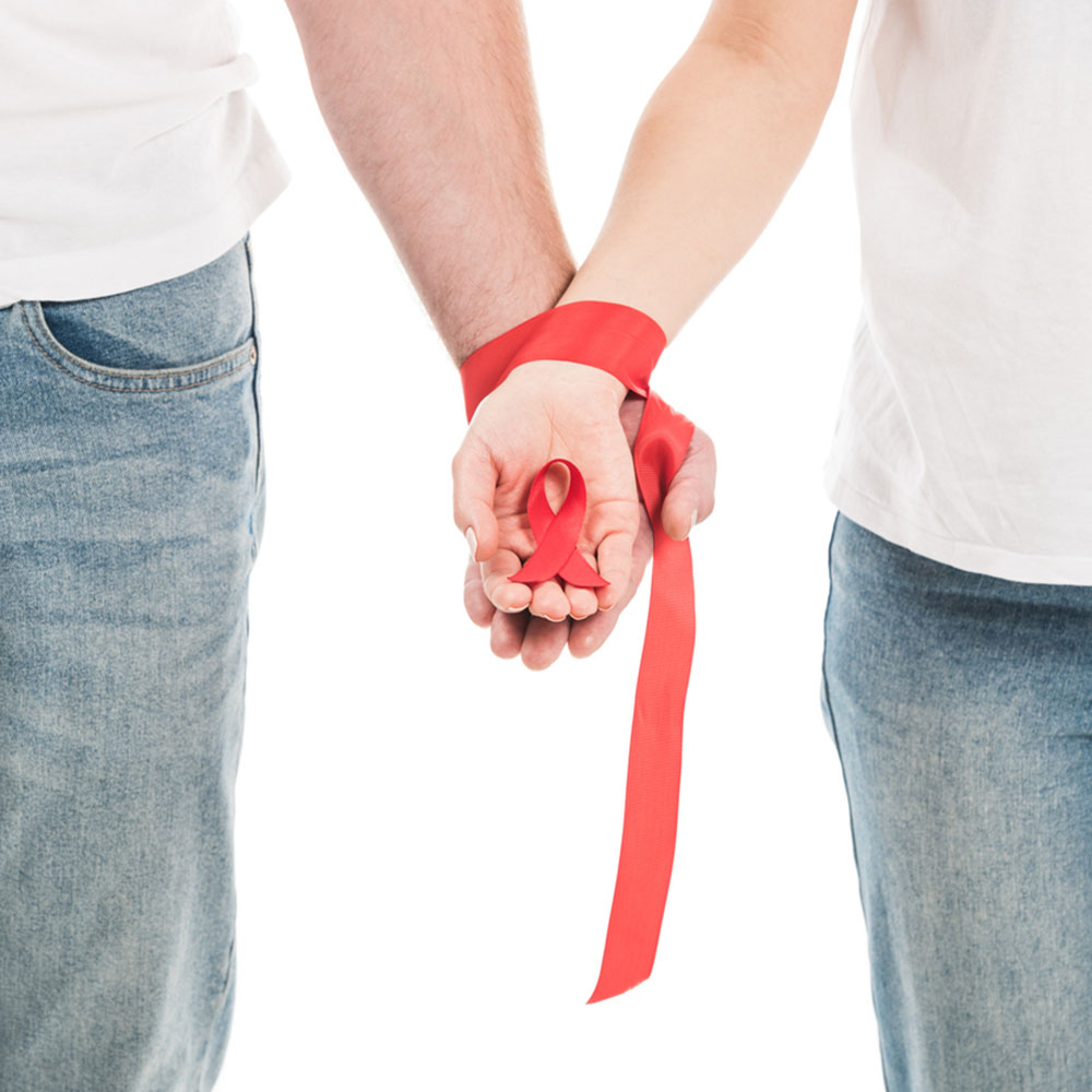 Two Hands Wrapped Together by and Holding Red Ribbon