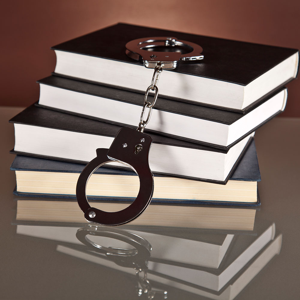 Handcuffs on Stack of Books